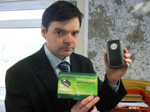 Warwickshire-Trading-Standards-Officer-Simon-Cripwell-with-one-of-the-electricity-saving-boxes
